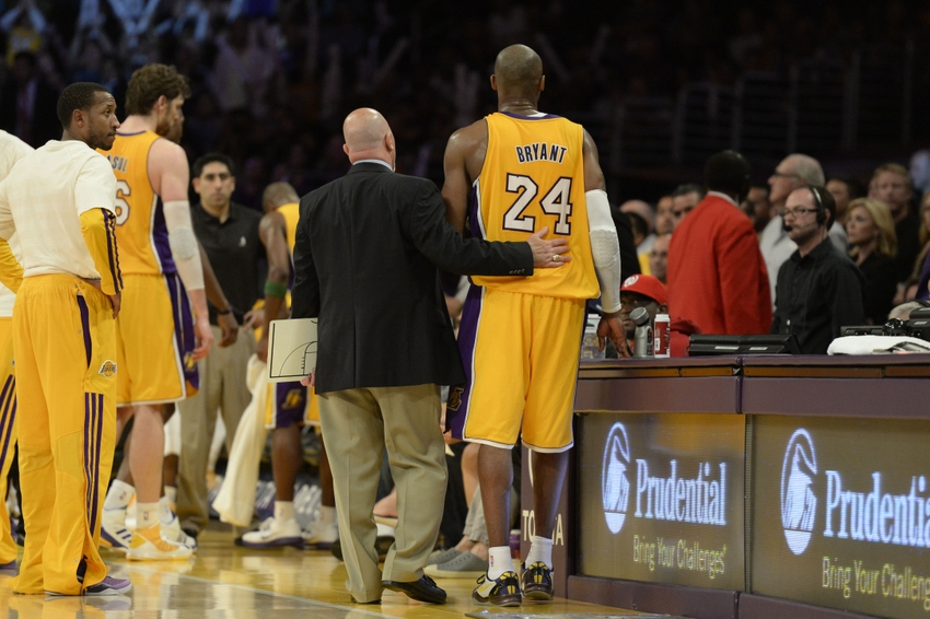 94d5fcf682b Apr 12, 2013; Los Angeles, CA, USA; Los Angeles Lakers shooting guard Kobe  Bryant (24) walks with a medical staff member against the Golden State  Warriors ...
