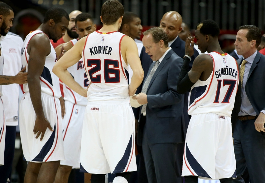 Oct 20 2014 Atlanta GA USA Hawks Head Coach Mike Budenholzer Talks With Players Including Guard Kyle Korver 26 And Dennis
