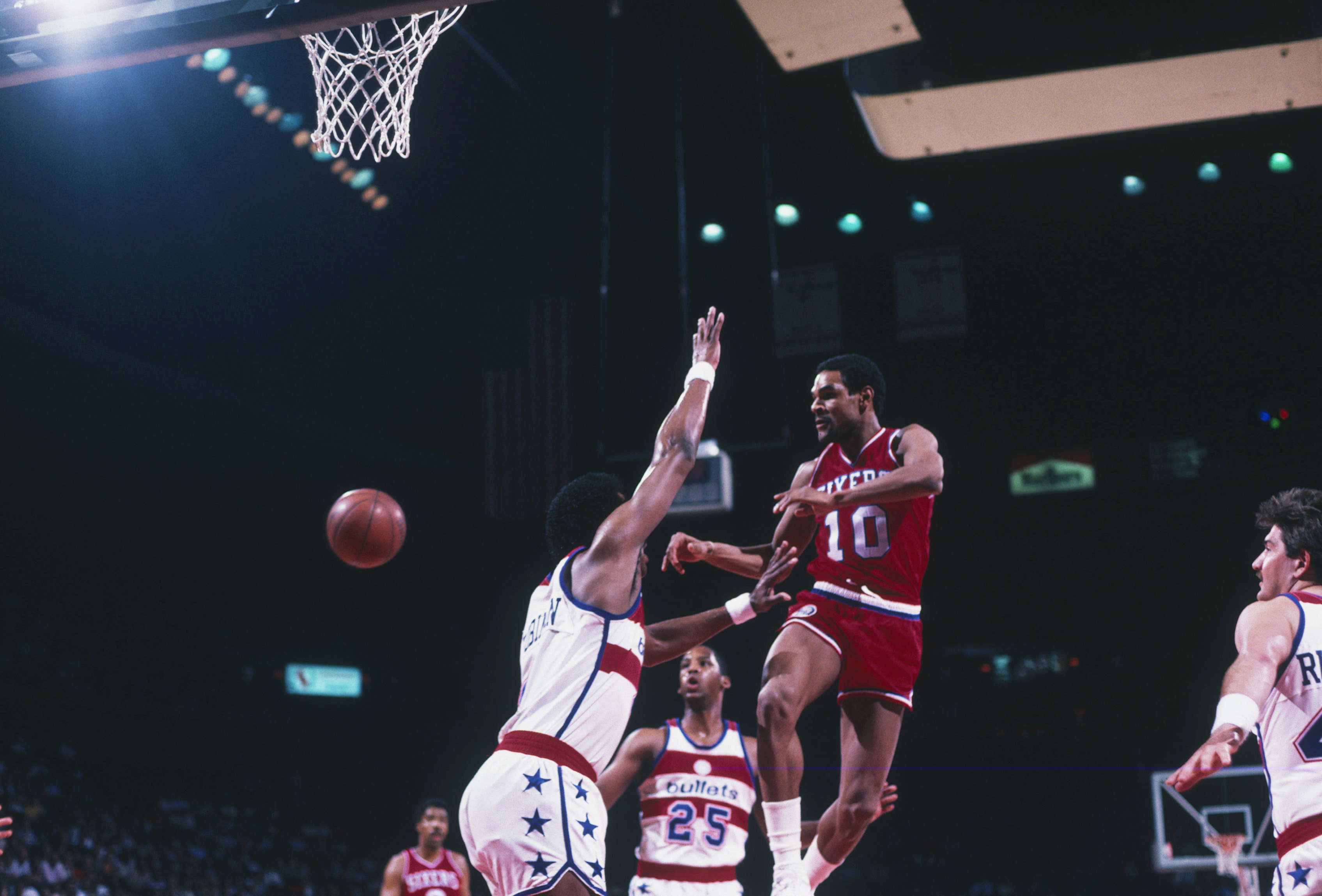 ... WASHINGTON – 1984 Philadelphia 76ers Maurice Cheeks 10 jumps and passes  near the net during a ... 088e3712d