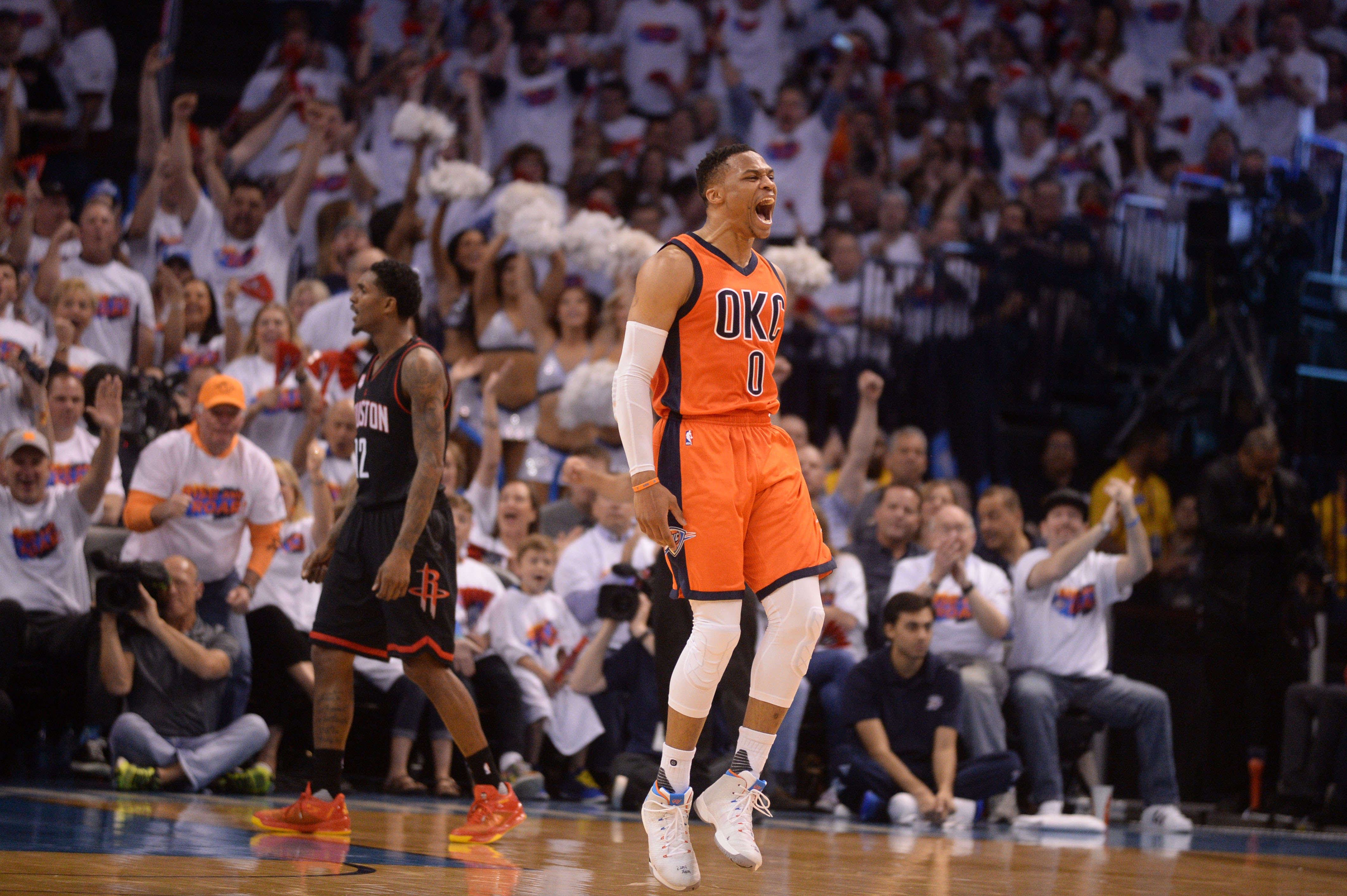 Apr 23, 2017 Oklahoma City, OK, USA Oklahoma City Thunder guard Russell  Westbrook (0) and Houston Rockets guard Lou Williams (12) react after a  play ...