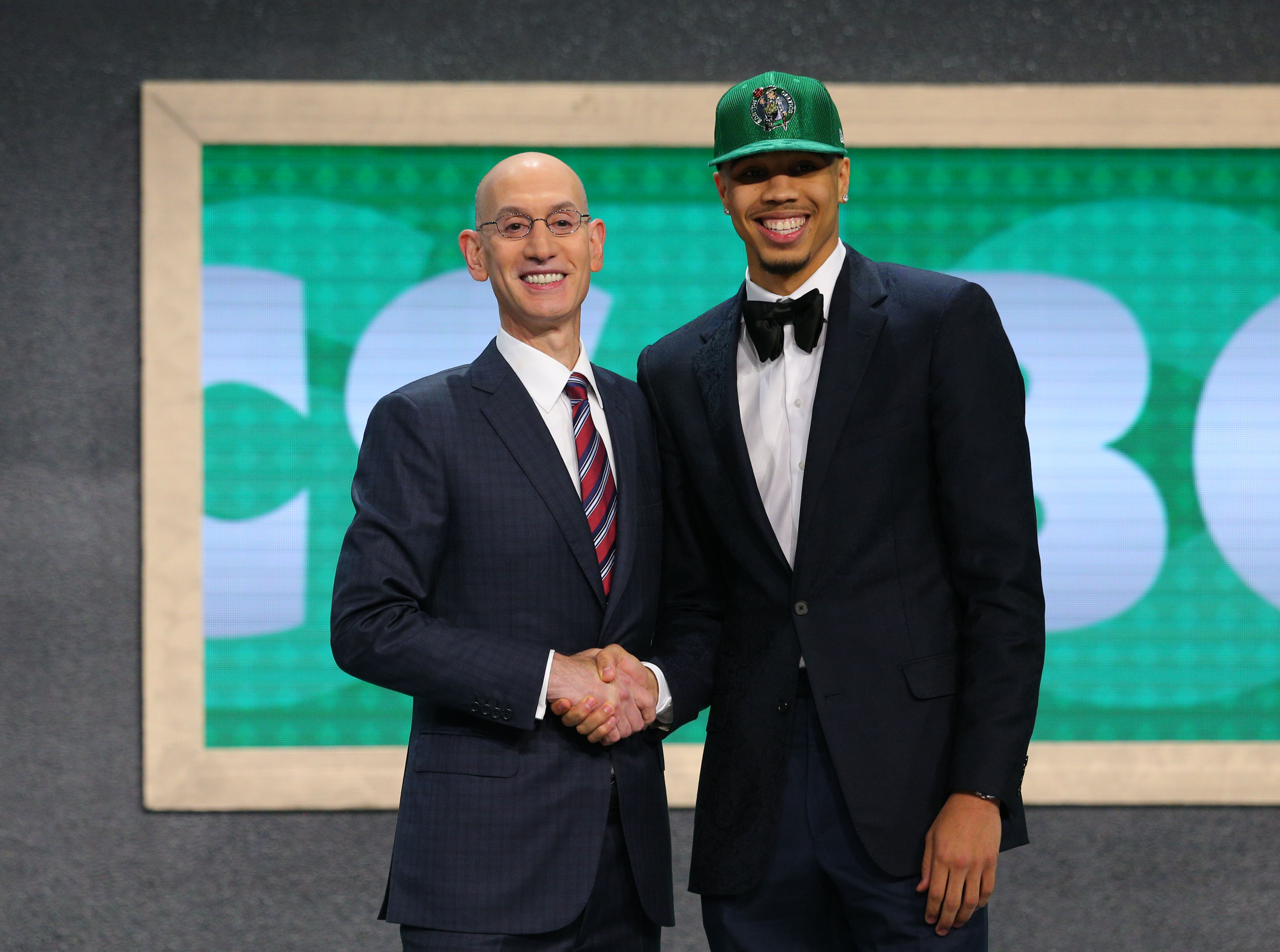 Jun 22, 2017; Brooklyn, NY, USA; Jayson Tatum (Duke) is introduced by NBA  commissioner Adam Silver as the number three overall pick to the Boston  Celtics in ...